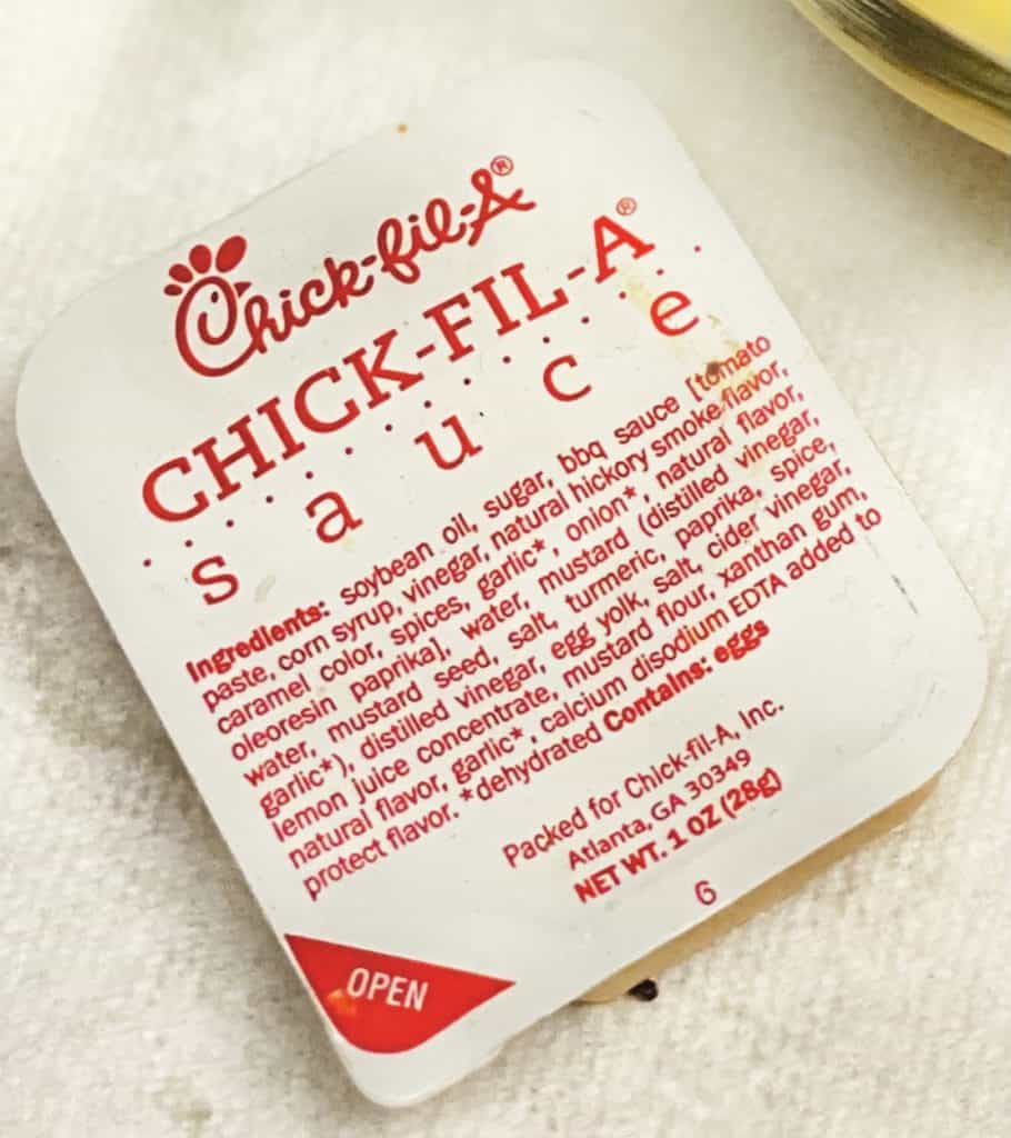 The ingredients list on the top of a chick-fil-a sauce packet