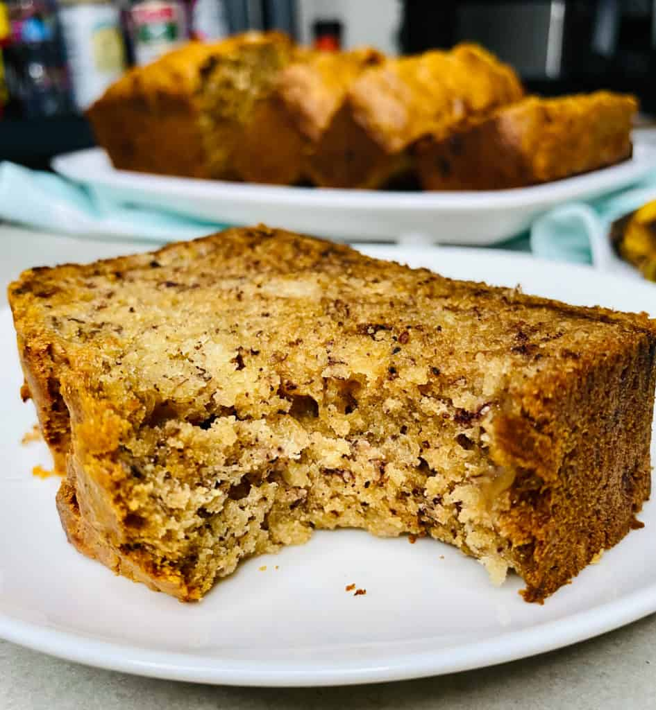 close up photo of a slice of a banana bread with a bite taken out