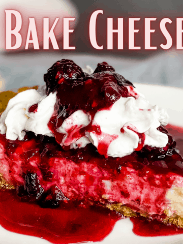 Slice of cheesecake with macerated berries and whipped cream on top with superimposed text that reads no-bake cheesecake vegan