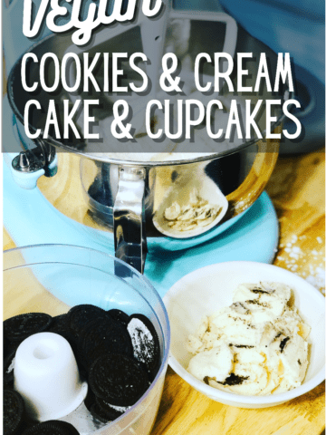 A food processor full of empty oreo cookies and a bowl full of the filling sitting in front of a light blue colored kitchenaid mixer on a butcherblock counter with text that reads vegan cookies and cream cake and cupcakes